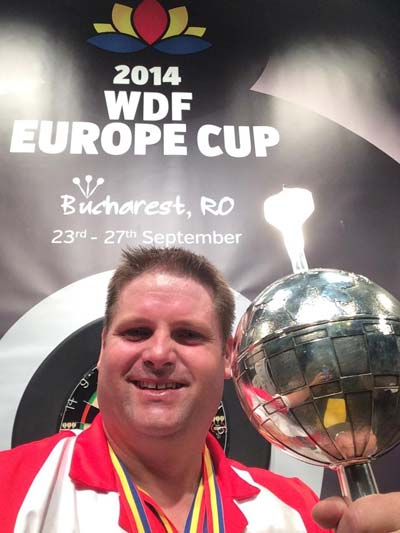 Scott holding the WDF Europe Cup August 2014 - Scott Mitchell Timeline
